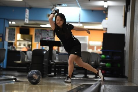 Michelle Ng sends a ball rolling down the lane.