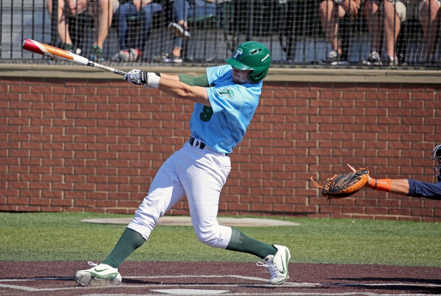 Redshirt sophomore first baseman Grant Matthews slams a hit to score the Green Wave a run. Matthews cut the Boilermakers lead on Saturday with this crucial hit.
