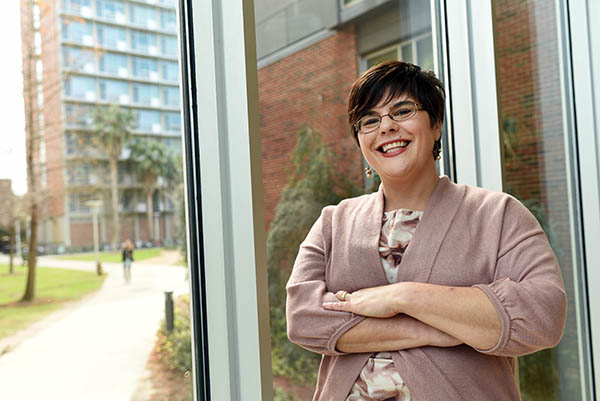 Christine Smith, a professor of practice in the accounting department, poses in the Goldring/Woldenberg Business Complex.