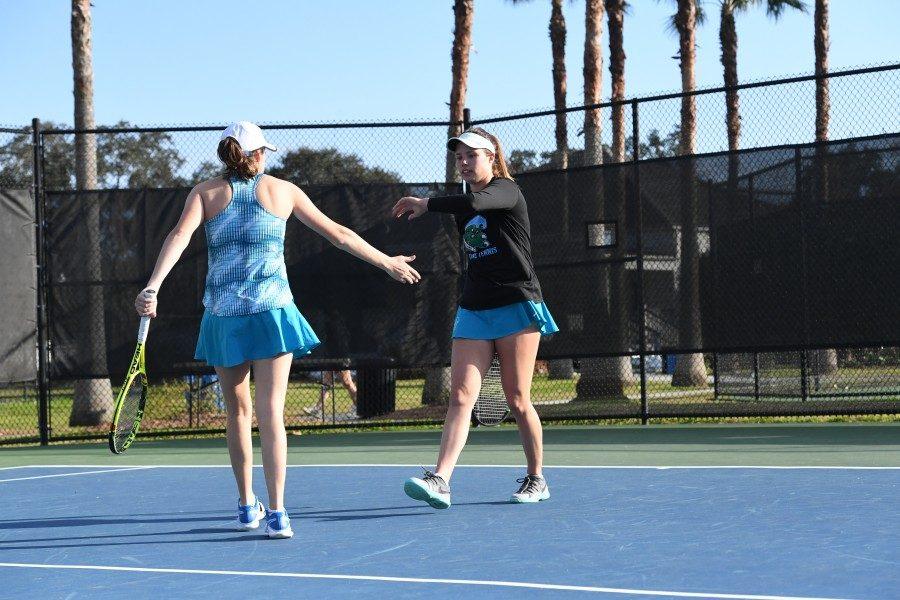 Sophomore Daniela La Fuente high fives a teammate after a match.
