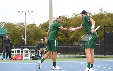 Men's tennis team gains momentum, improves record
