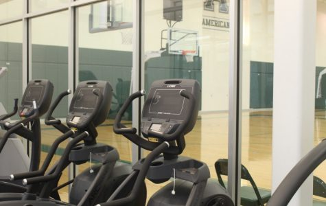 The altitude chamber looks out on a practice basketball court in the Hertz Center.