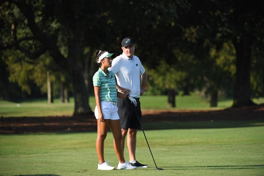 Tulane women's golf team welcomes new head coach Stew Burke pictured here with freshman Hanna Liu to guide them this season.