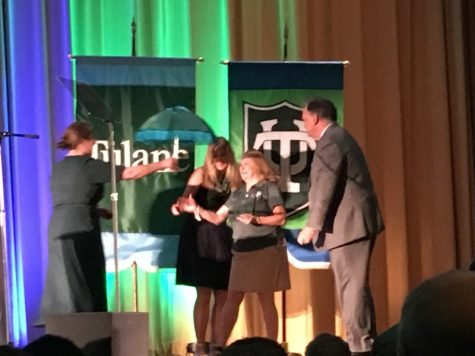 Rebecca Otten, Associate Director of Social Innovation Strategy at the Taylor Center, receive a Tulane Spirit award.