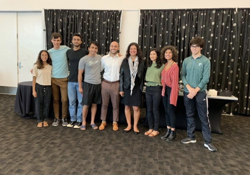 Congresswoman Rashida Tlaib poses with the executive board of the Tulane Muslim Students Association