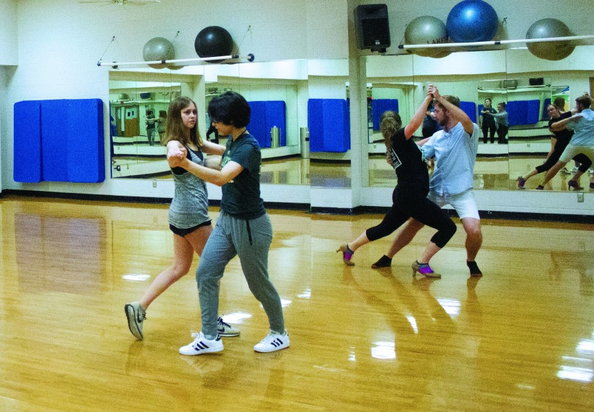 From left to right, Emma Pronovost, Yume Jensen, Elizabeth Grimm and Andrew Cerise practice tangoing with each other.