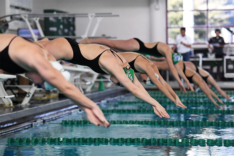 The swim team, shown here diving, recently announced its 2019-20 schedule.