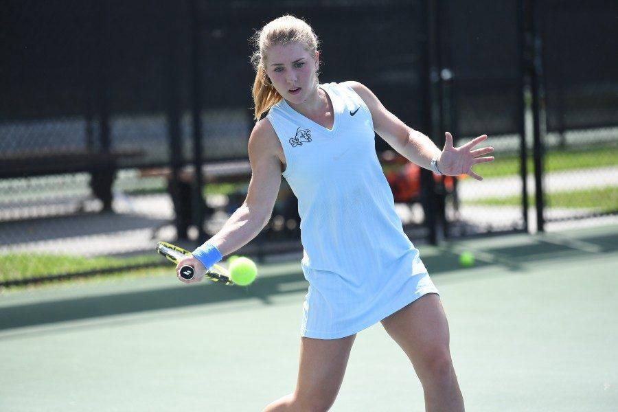 Redshirt Sophomore Lauren Gish returns a shot.