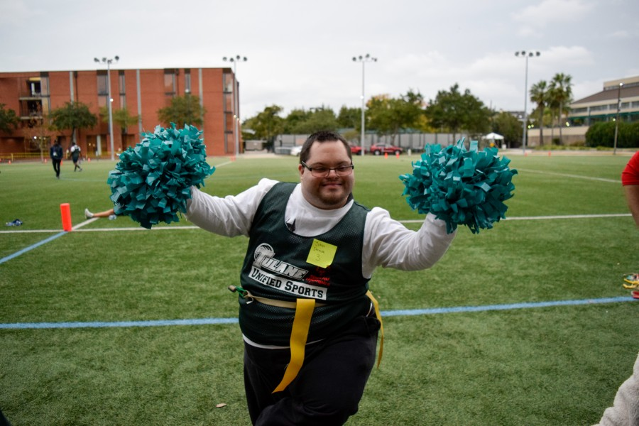 A+participant+in+the+Tulane+Special+Olympics+club+dances+with+pompoms.+