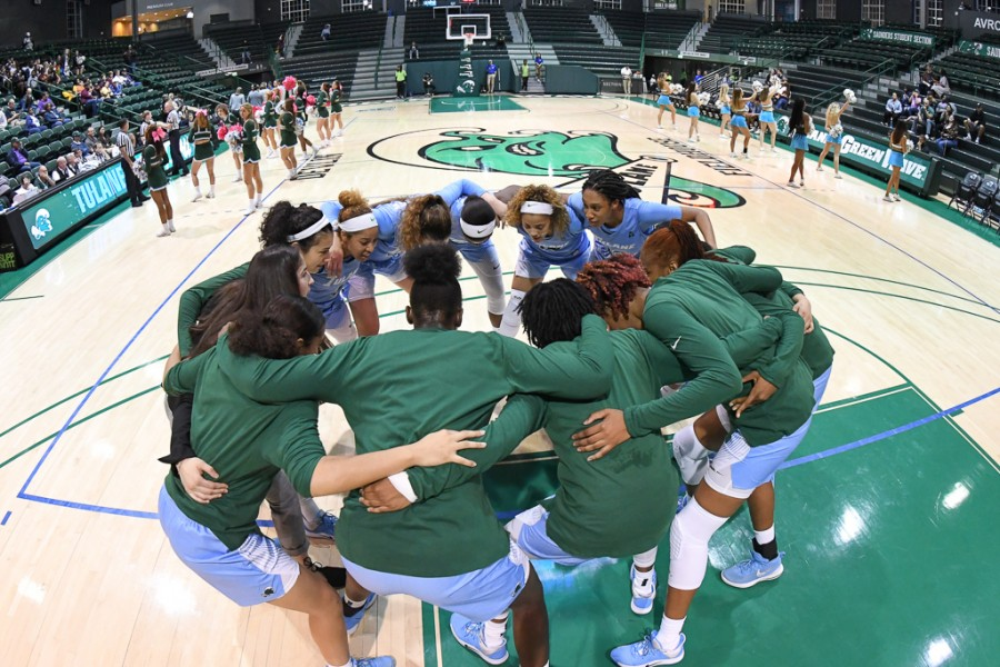 The Green Wave women's basketball squad huddled up during its scrimmage against Loyola