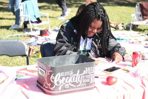 Student participates in activity at the Celebrate Mental Health Festival this Saturday.
