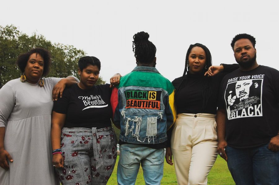 Carl Briggs, Inas Shabazz, Justin Taylor, Maiya Tate, Janelle Williams pose in front of Newcomb Hall.