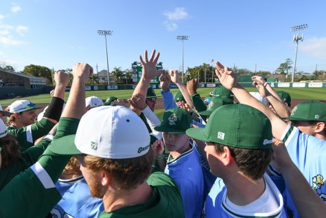 The Green Wave baseball team huddles before a scrimmage on Friday as the team prepares for the upcoming 2020 season.