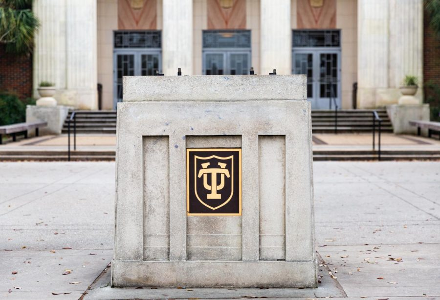 An empty pedestal stands in front of McAlister Auditorium where the Victory Bell once stood.