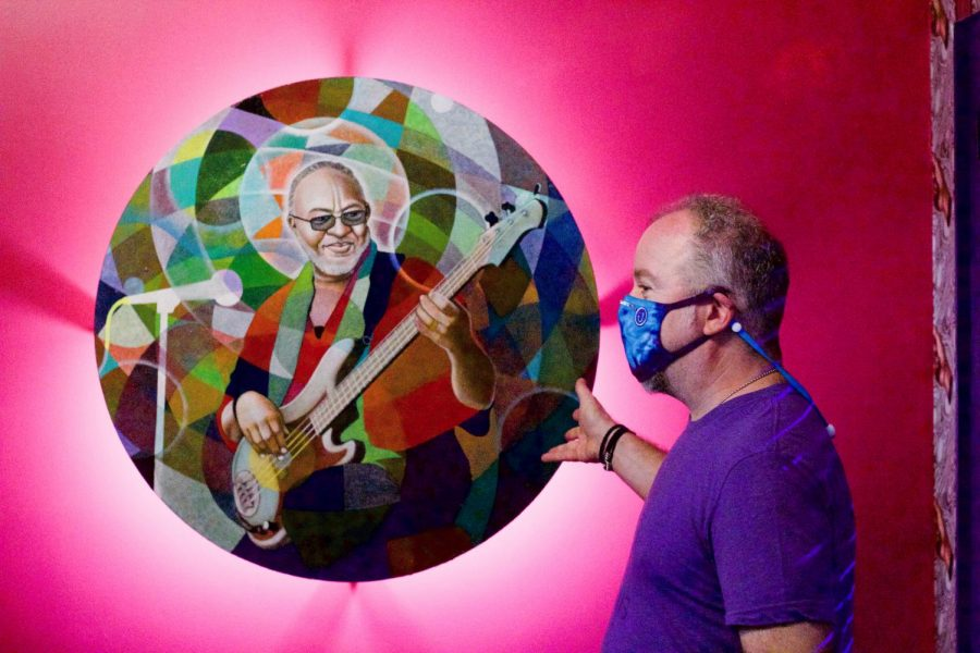 jonny liss with artwork of george porter jr.