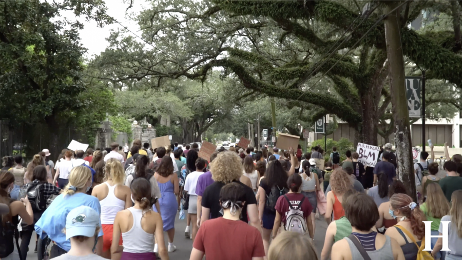 Tulane and Loyola  students gather on campus for speeches and march through Audubon Park in a demonstration protesting TUPD.
