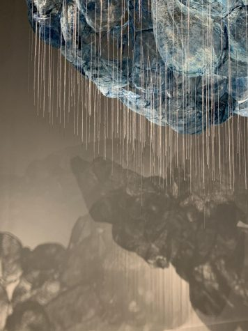 picture of cloud art exhibit with needles hanging down at a museum