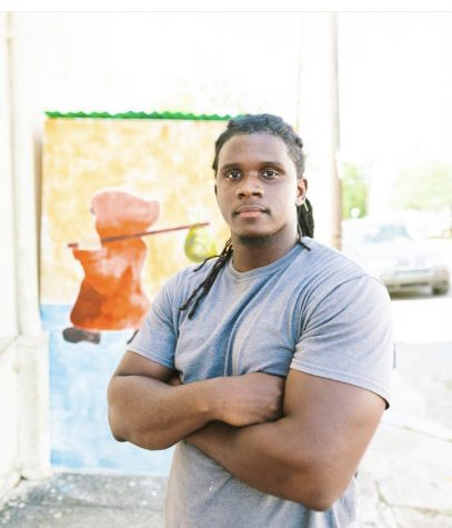brandon surtain stands in front of a piece of his artwork outside