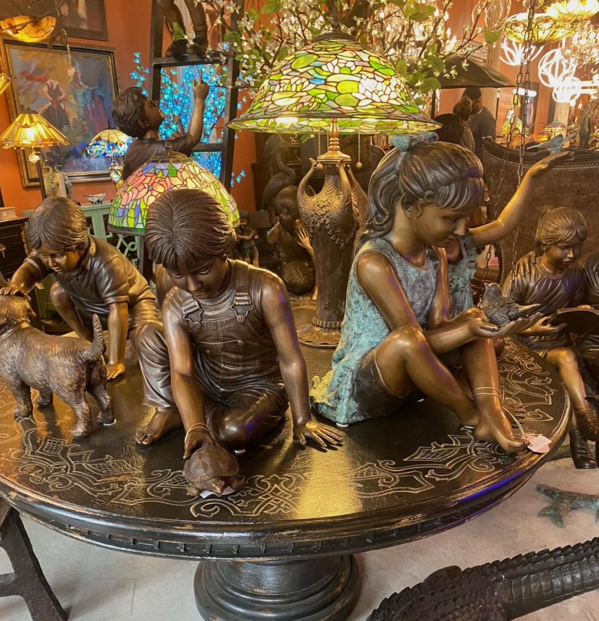 photo of antique statues of children and lamps