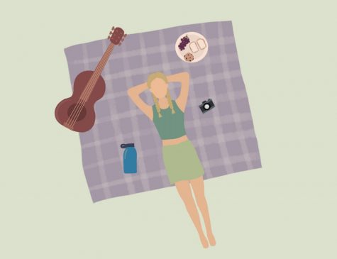 girl laying on picnic blanket with guitar and food to have fun