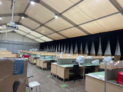 Photo of desks cramped together in temporary buildings.