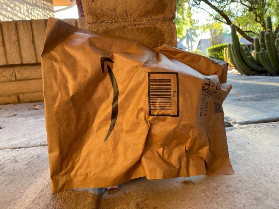 Photo of an opened Amazon package on the ground.