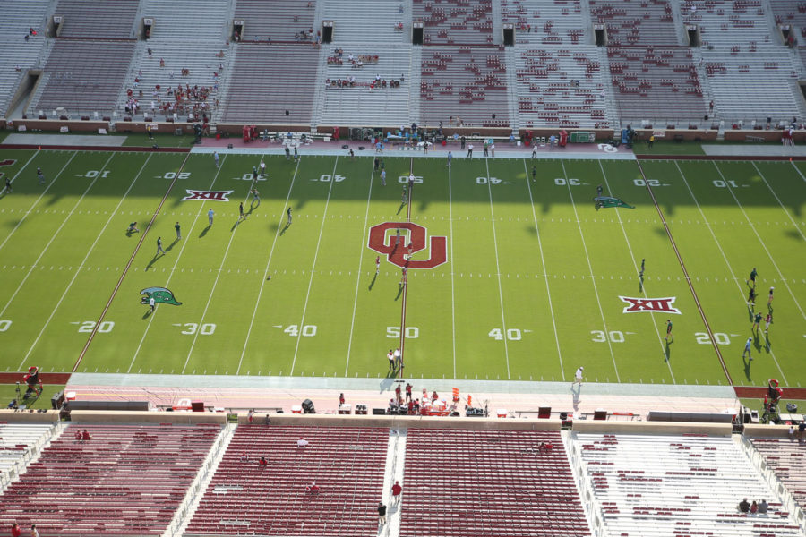 The field at Gaylord Family Oklahoma Memorial Stadium emblazoned with Tulane