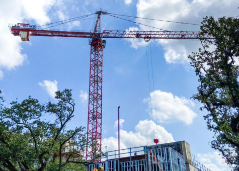 A self-erecting crane sits above McAlister Place at Tulane University as construction continues.