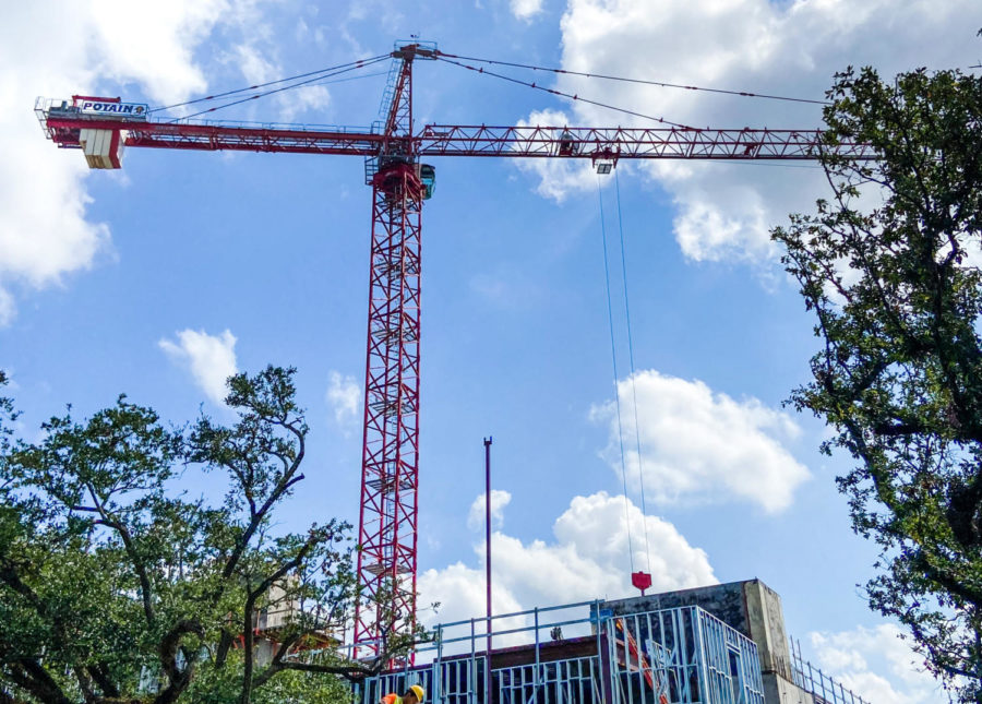 A self-erecting crane sits above McAlister Place at Tulane University.