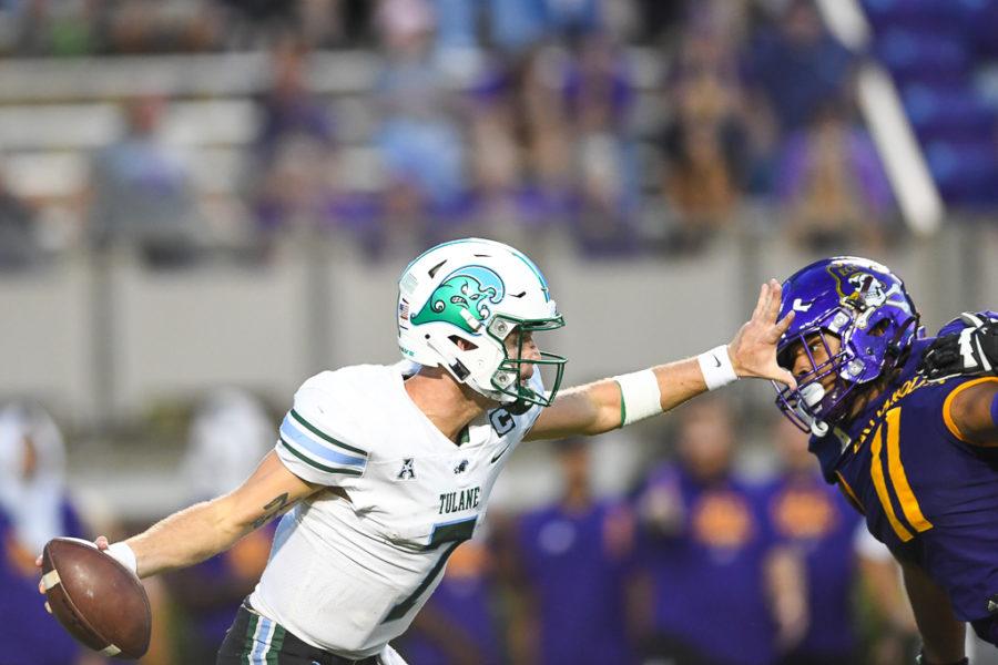 Tulane quarterback Michael Pratt sheds a defender in Saturdays loss to ECU.